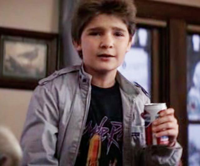 Corey Feldman in the 80s wearing a Members Only jacket