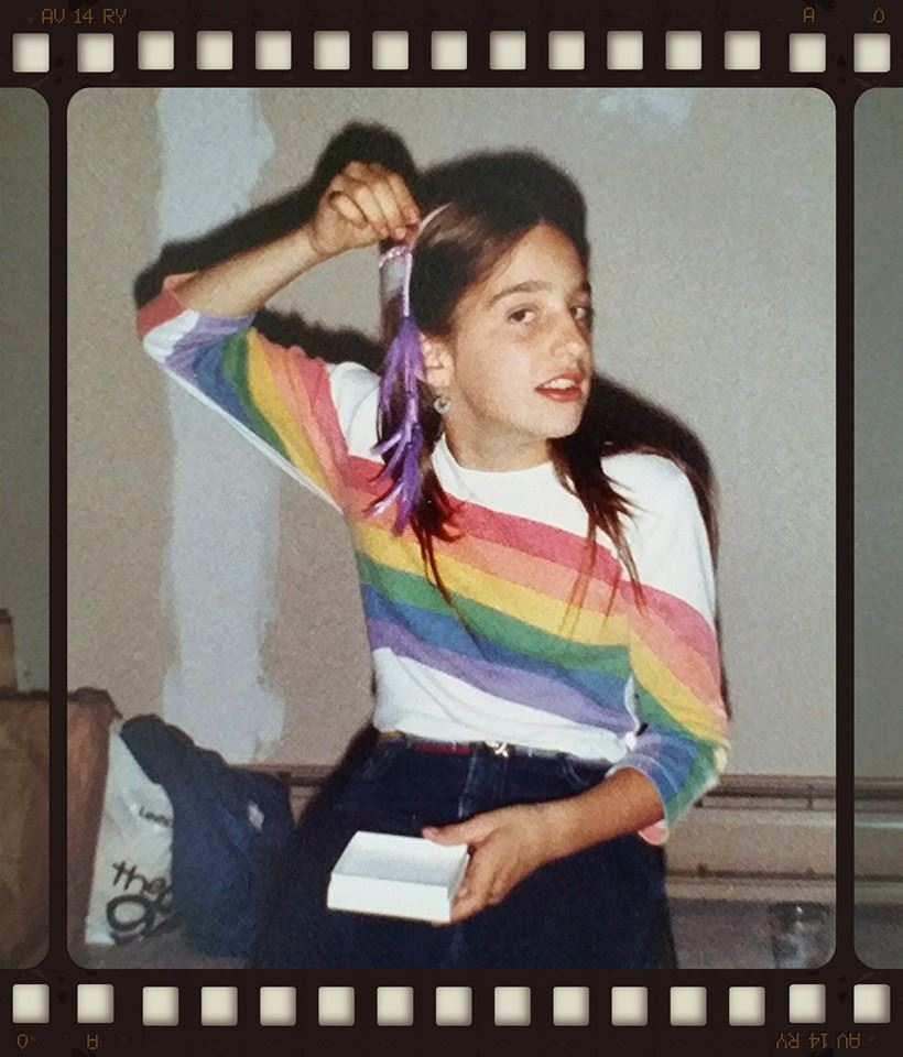 The perfect 80s combo: the rainbow tee with the feather roach clip.  Hello, 1982, we miss you!