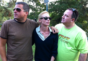 Alli of Like Totally 80s striking a U2 pose with Sean and Steve of Stuck in the 80s