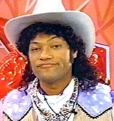 """Cowboy Curtis, """"You know what they say, big feet...big boots!"""""""