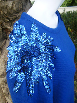 Blue sweater dress with sequence bursts on the shoulders (photo credit: VinTaGeOus)