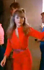 "E.G. Daily wearing a red jumpsuit in ""Valley Girl"""