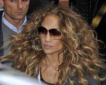 JLo rocks big hair & big glasses while in London