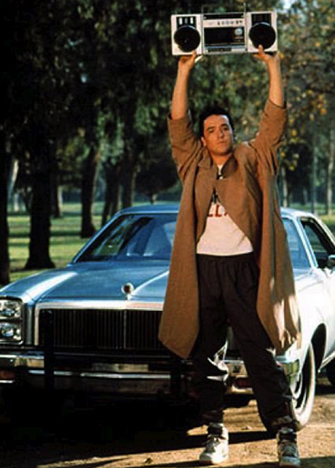 Lloyd Dobler wearing a trenchcoat in 'Say Anything' holding boombox in the air