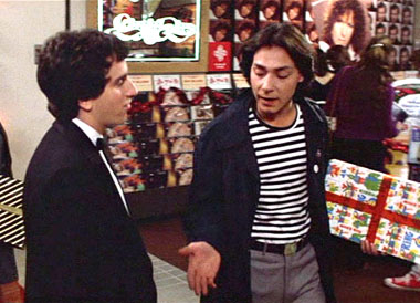 Mike Damone (Robert Romanus) giving Mark 'Rat' Ratner (Brian Backer) dating advise.