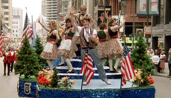 "Ferris jumps on a float and sings ""Danke Schoen"" and ""Twist and Shout"" in the Von Steuben Day Parade."