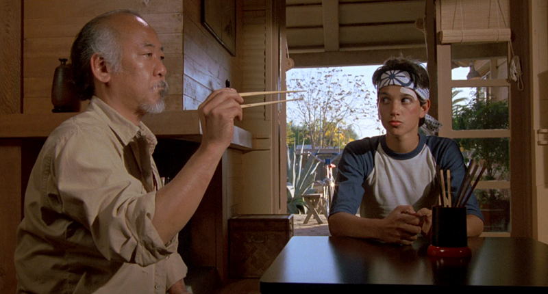 Mr. Miyagi catches a fly with chopsticks