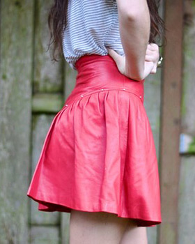 Cute red leather mini skirt with gold studs!