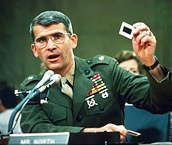 1986 - Iran-Contra Affair: Oliver North shredds documents implicating himself in selling weapons to Iran and channeling the proceeds to fund Contra rebels in Nicaragua