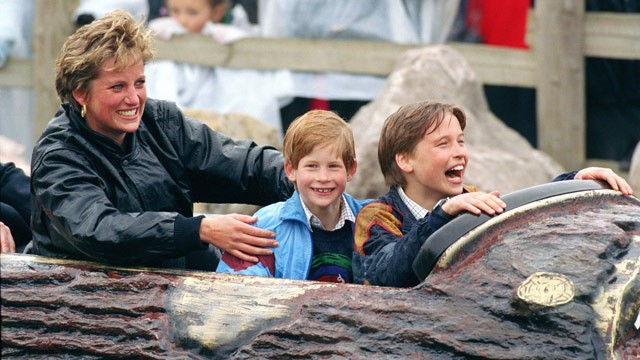 Prince William and Prince Harry enjoy a log floom ride with their mother