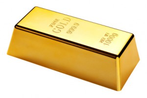 Photo of a 1kg gold bar isolated on a white background with clipping path